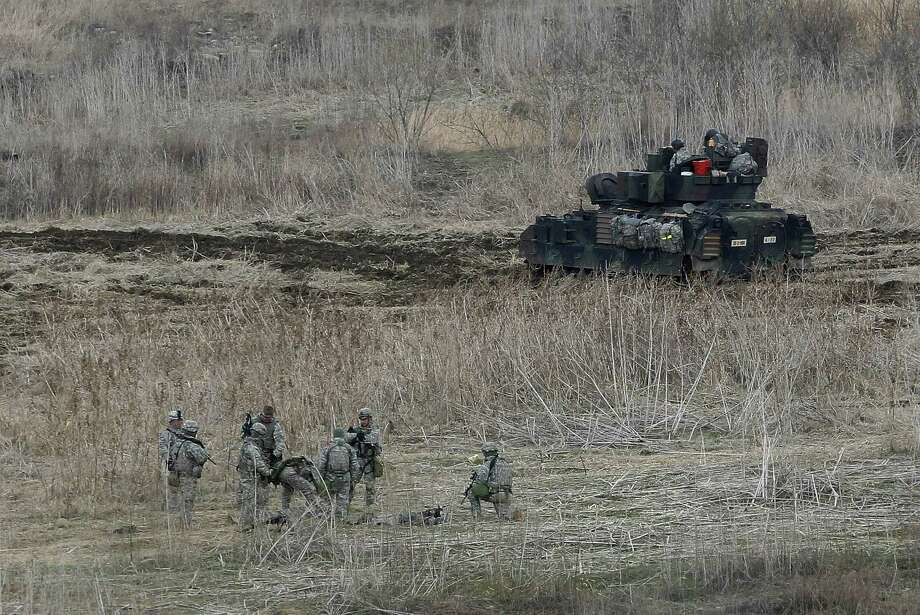 U.S. soldiers conduct their annual military drills in Yeoncheon, South Korea, near the border with North Korea. North Korea recently has threatened South Korea with nuclear war. Photo: Ahn Young-joon / Associated Press