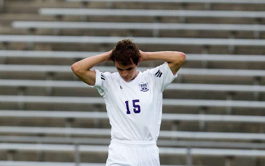 Ridge Point midfielder Colton Contorno (15) walks slowly off the field after losing to Houston Lee 5-1 during the Class 4A region soccer quarterfinals at Mercer Stadium on Tuesday, April 9, 2013, in Sugar Land. Photo: J. Patric Schneider, For The Chronicle / © 2013 Houston Chronicle
