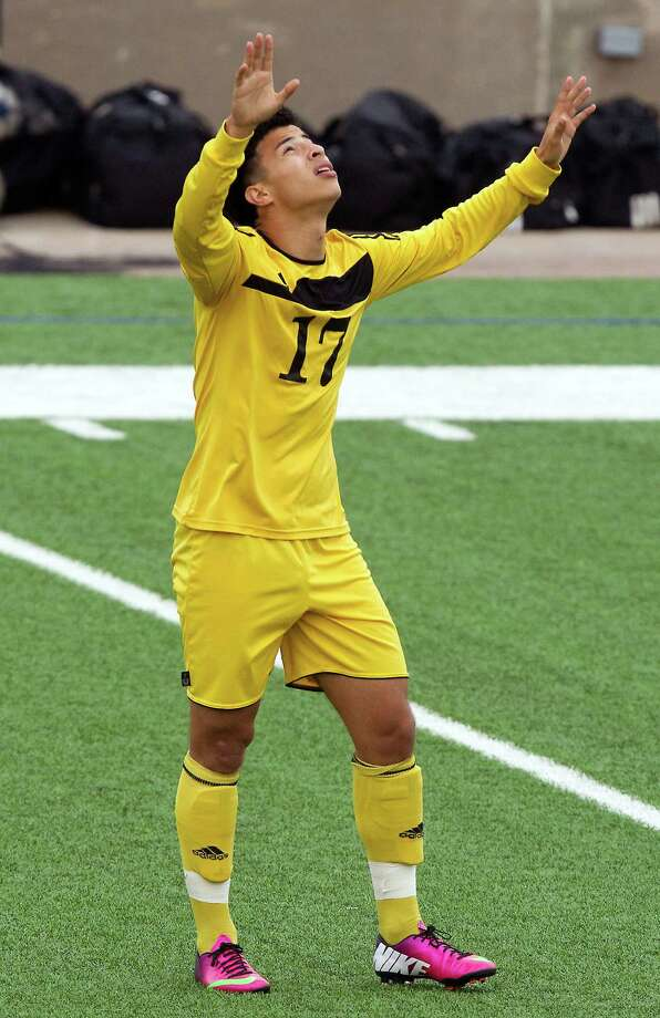 Houston Lee's Jonathan Salgado (17) looks to the heavens after scoring a goal during the first half of the Class 4A region soccer quarterfinals against Ridge Point at Mercer Stadium on Tuesday, April 9, 2013, in Sugar Land. Photo: J. Patric Schneider, For The Chronicle / © 2013 Houston Chronicle