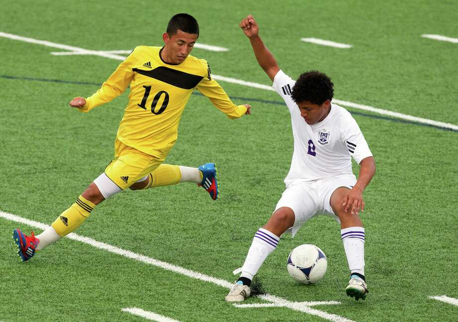 Ridge Point midfielder Marco Barahona (2) dribbles past Houston Lee's Freddy Gavarrete (10) during the fist half of the Class 4A region soccer quarterfinals at Mercer Stadium on Tuesday, April 9, 2013, in Sugar Land. Photo: J. Patric Schneider, For The Chronicle / © 2013 Houston Chronicle