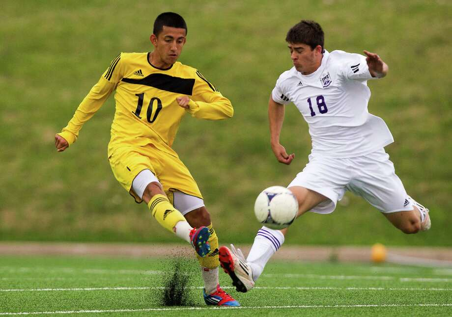 Houston Lee's Freddy Gavarrete (10) fights for the ball with Ridge Point Thomas Batchelor (18) during the second half of the Class 4A region soccer quarterfinals at Mercer Stadium on Tuesday, April 9, 2013, in Sugar Land. Photo: J. Patric Schneider, For The Chronicle / © 2013 Houston Chronicle