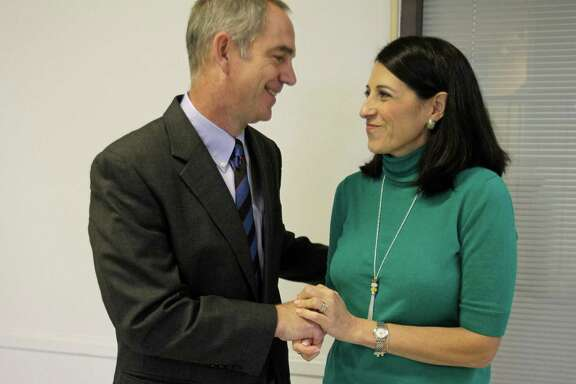 Greg and Michelle Groogan have a moment together during a break in a hearing Monday about their autistic son, Garrett.