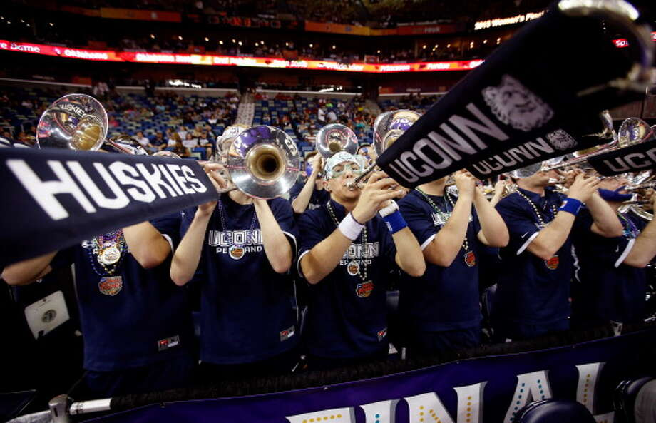Members of the Connecticut Huskies Pep Band perform prior to the game against the Louisville Cardinals during the 2013 NCAA Women\'s Final Four Championship at New Orleans Arena on April 9, 2013 in New Orleans, Louisiana. Photo: Chris Graythen, Getty Images / 2013 Getty Images