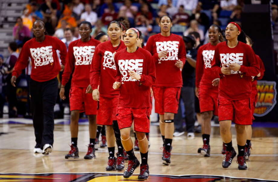 The Louisville Cardinals warm up prior to the game against the Connecticut Huskies during the 2013 NCAA Women\'s Final Four Championship at New Orleans Arena on April 9, 2013 in New Orleans, Louisiana. Photo: Chris Graythen, Getty Images / 2013 Getty Images