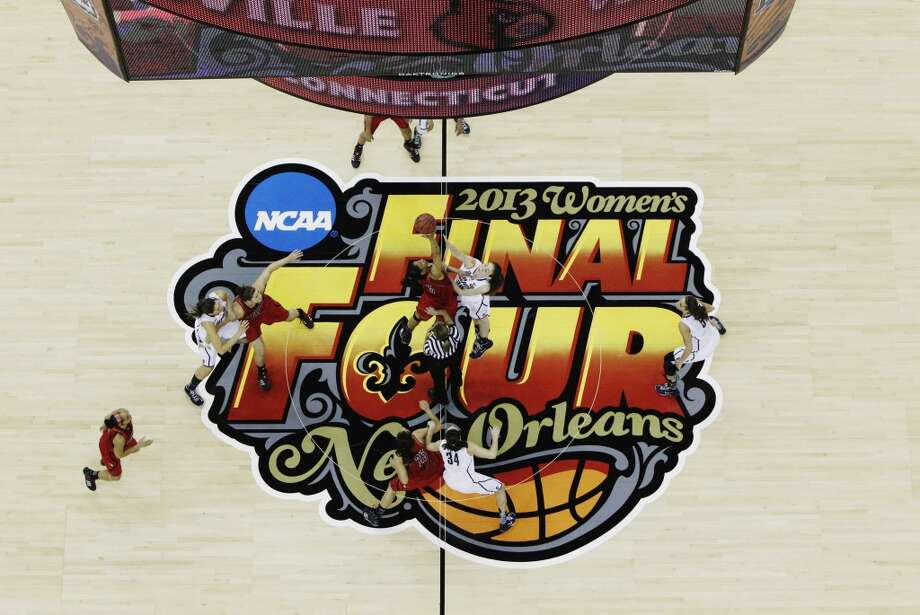 Louisville and Connecticut tip the ball to start the first half of the national championship game of the women\'s Final Four of the NCAA college basketball tournament, Tuesday, April 9, 2013, in New Orleans.