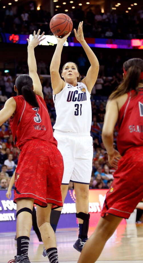 Stefanie Dolson #31 of the Connecticut Huskies shoots against Sheronne Vails #3 of the Louisville Cardinals in the first half during the 2013 NCAA Women\'s Final Four Championship at New Orleans Arena on April 9, 2013 in New Orleans, Louisiana. Photo: Chris Graythen, Getty Images / 2013 Getty Images