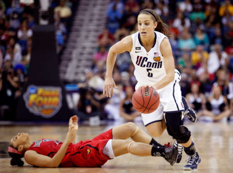 Caroline Doty #5 of the Connecticut Huskies commits a flagrant foul against Bria Smith #21 of the Louisville Cardinals in the first half during the 2013 NCAA Women\'s Final Four Championship at New Orleans Arena on April 9, 2013 in New Orleans, Louisiana. Photo: Chris Graythen, Getty Images / 2013 Getty Images