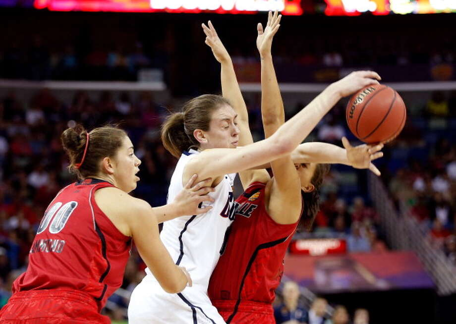 Breanna Stewart #30 of the Connecticut Huskies handles the ball against Sara Hammond #00 and Shoni Schimmel #23 of the Louisville Cardinals in the first half during the 2013 NCAA Women\'s Final Four Championship at New Orleans Arena on April 9, 2013 in New Orleans, Louisiana. Photo: Chris Graythen, Getty Images / 2013 Getty Images