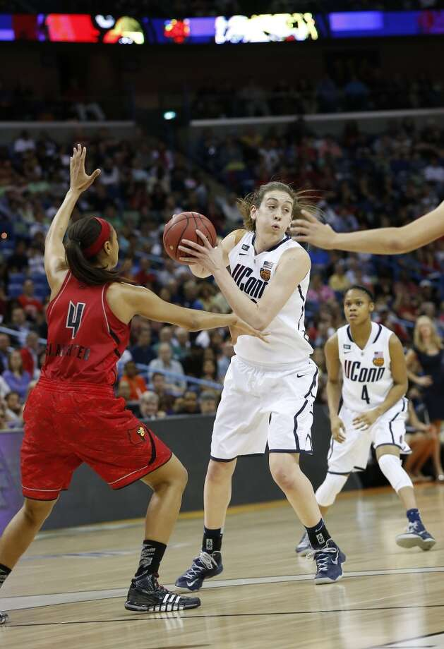 Connecticut forward Breanna Stewart (30) looks to pass against Louisville guard Antonita Slaughter (4) during first half of the national championship game of the women\'s Final Four of the NCAA college basketball tournament, Tuesday, April 9, 2013, in New Orleans.