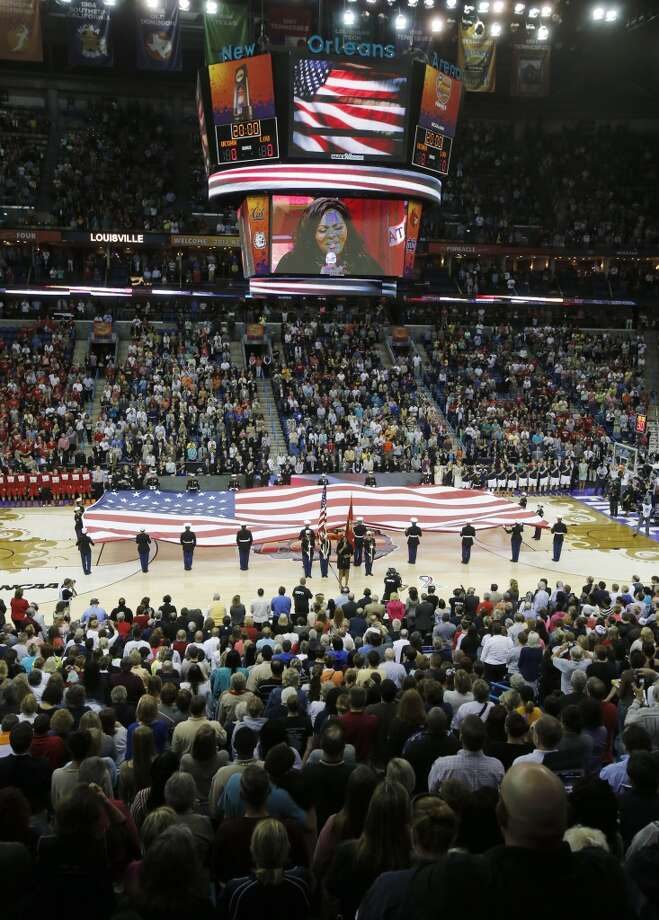 Kym Hampton performs the national anthem before the national championship game between Connecticut and Louisville at the women\'s Final Four of the NCAA college basketball tournament, Tuesday, April 9, 2013, in New Orleans.