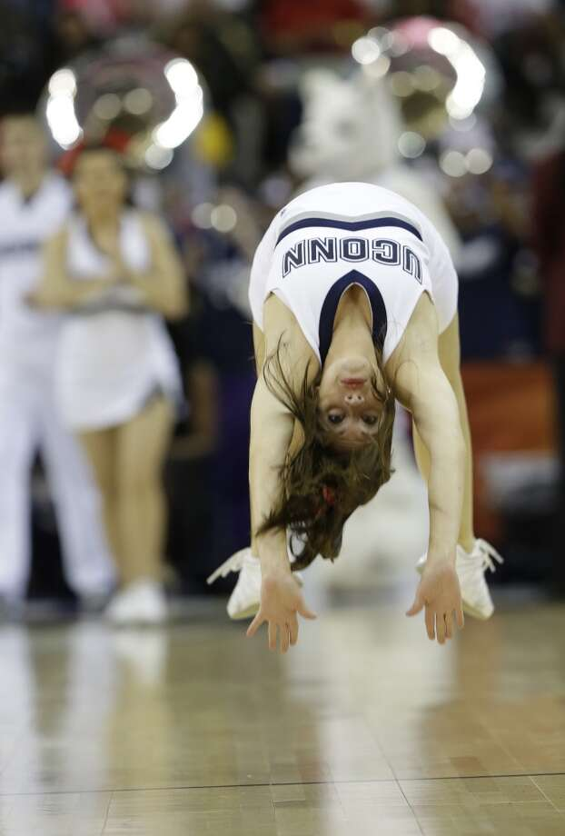 Connecticut cheerleaders perform against Louisville during first half of the national championship game of the women\'s Final Four of the NCAA college basketball tournament, Tuesday, April 9, 2013, in New Orleans.