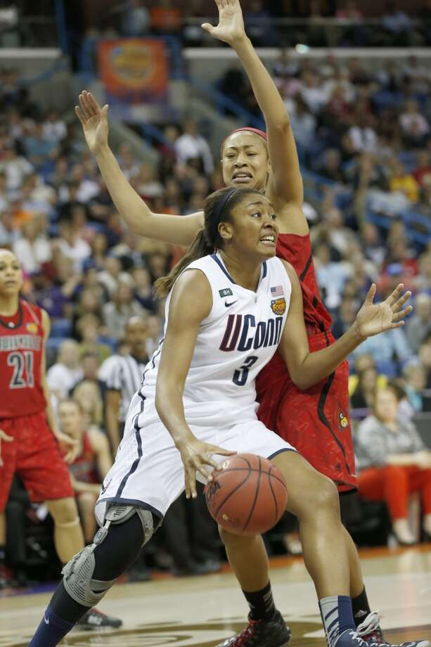 Connecticut forward Morgan Tuck (3) drives the ball against Louisville guard Antonita Slaughter (4) during first half of the national championship game of the women\'s Final Four of the NCAA college basketball tournament, Tuesday, April 9, 2013, in New Orleans.