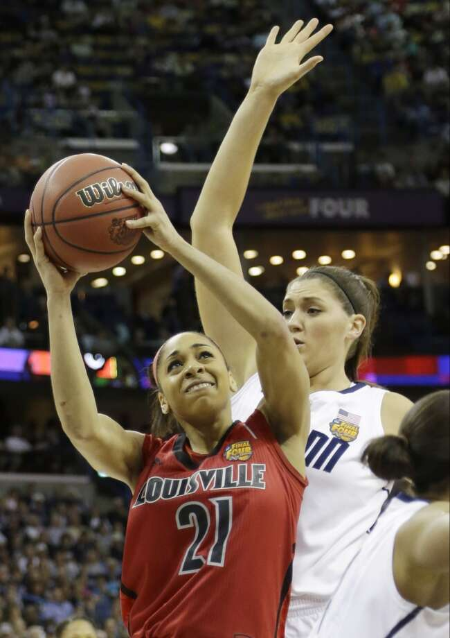 Louisville guard Bria Smith (21) goes up for a shot against Connecticut center Stefanie Dolson (31) during first half of the national championship game of the women\'s Final Four of the NCAA college basketball tournament, Tuesday, April 9, 2013, in New Orleans.
