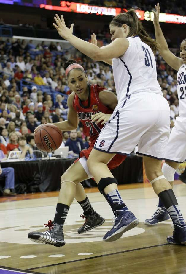 Louisville guard Bria Smith (21) drives against Connecticut center Stefanie Dolson (31) during first half of the national championship game of the women\'s Final Four of the NCAA college basketball tournament, Tuesday, April 9, 2013, in New Orleans.
