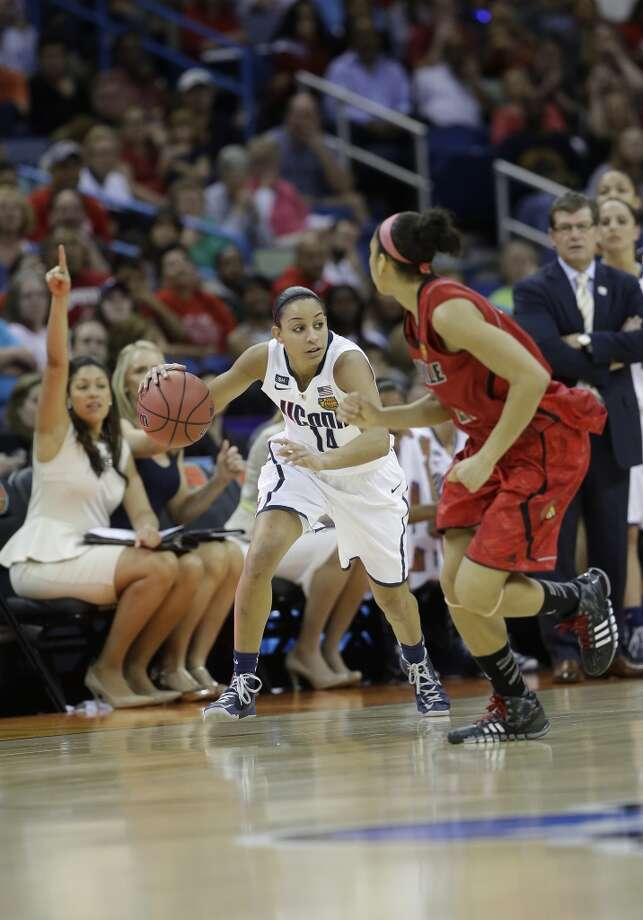 Connecticut guard Bria Hartley (14) moves the ball against Louisville during first half of the national championship game of the women\'s Final Four of the NCAA college basketball tournament, Tuesday, April 9, 2013, in New Orleans. (AP Photo/Dave Martin)