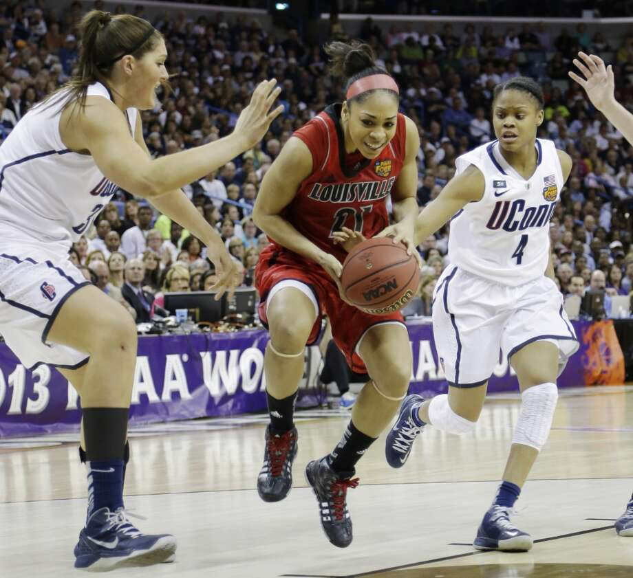 Louisville guard Bria Smith (21) drives the ball against Connecticut center Stefanie Dolson (31) and Connecticut guard Moriah Jefferson (4) during first half of the national championship game of the women\'s Final Four of the NCAA college basketball tournament, Tuesday, April 9, 2013, in New Orleans.