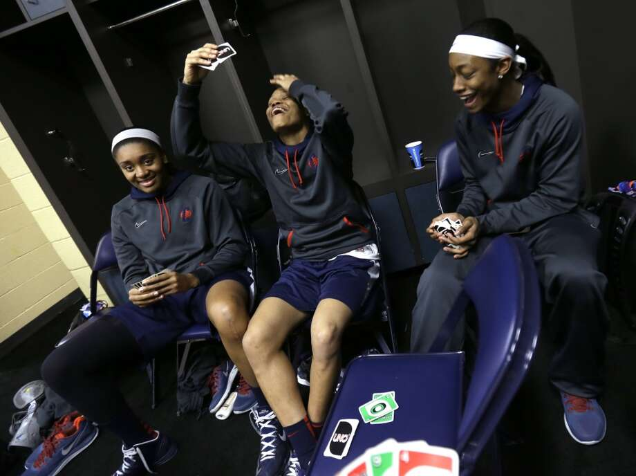 Connecticut\'s Morgan Tuck, Moriah Jefferson and Brianna Banks play cards in the locker room before practice for the women\'s NCAA Final Four college basketball tournament final, Monday, April 8, 2013, in New Orleans. UConn plays Louisville in the championship game on Tuesday.