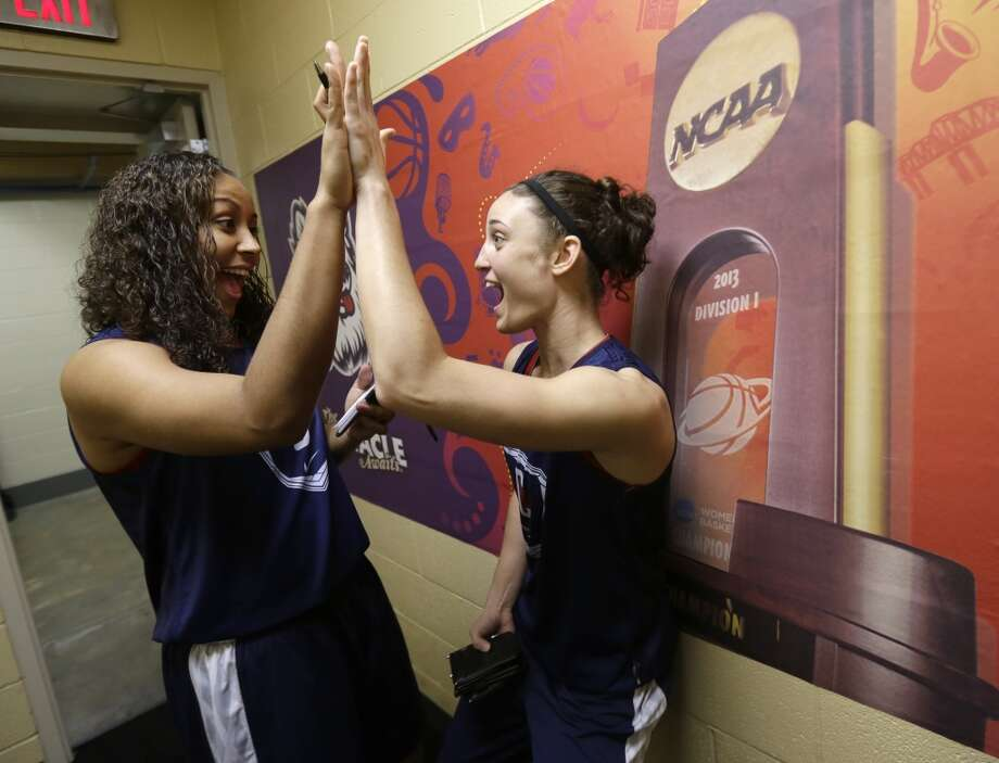 Connecticut forward Kaleena Mosqueda-Lewis and Kelly Faris high five before practice for the women\'s NCAA Final Four college basketball tournament final, Monday, April 8, 2013, in New Orleans. UConn plays Louisville in the championship game on Tuesday.