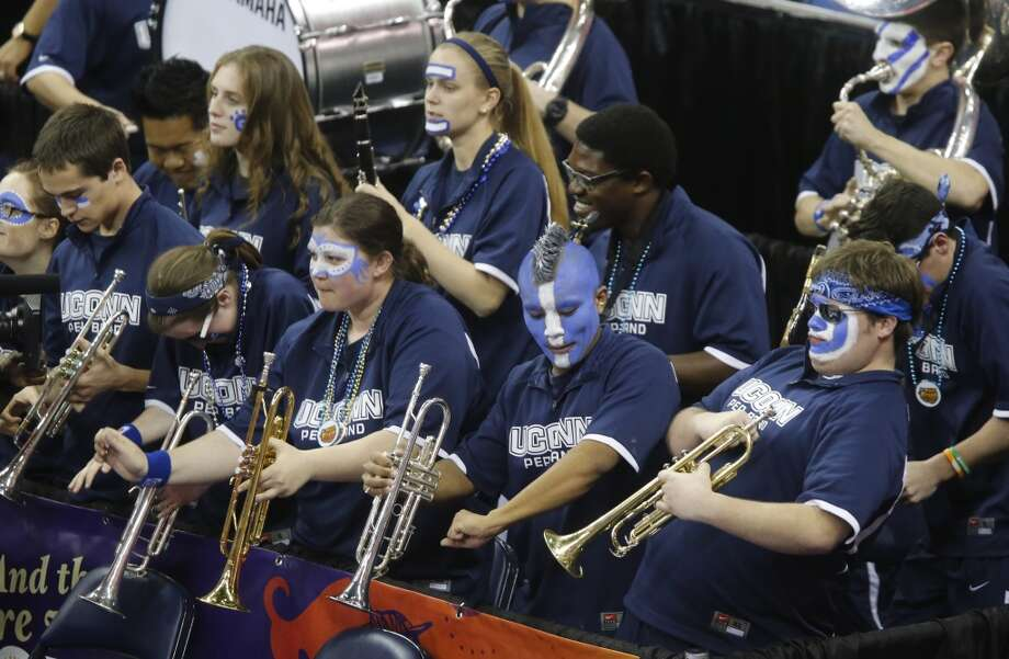 Connecticut band members prepare to perform before the women\'s NCAA Final Four tournament college basketball championship game against Louisville, Tuesday, April 9, 2013, in New Orleans.