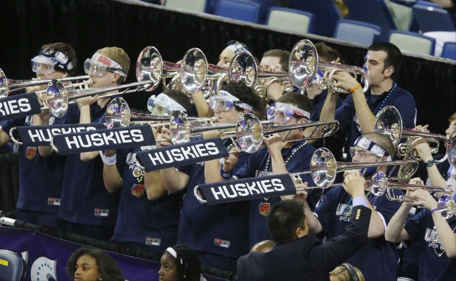 Connecticut band members perform before the women\'s NCAA Final Four tournament college basketball championship game against Louisville, Tuesday, April 9, 2013, in New Orleans.