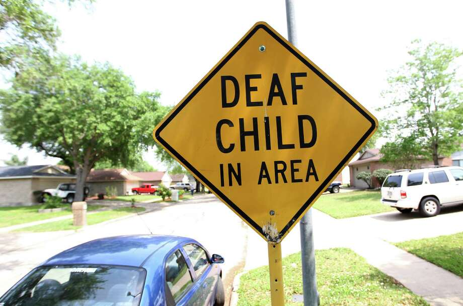 "A sign that reads ""Deaf Child in area"" on Jenikay Street,  Tuesday, April 9, 2013, in Houston, where the possible suspect in a mass stabbing incident at Lone Star College's Cypress-Fairlbanks campus, Dylan Quick, was reported to have lived. Photo: Karen Warren, Houston Chronicle / © 2013 Houston Chronicle"