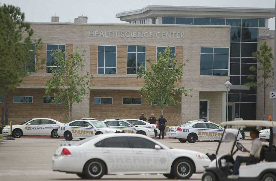 Harris County Sheriffs Officers secure the outside of the Health Science Center in the Cy-Fair campus of Lone Star College where 14 people were wounded in a stabbing. Photo: Mayra Beltran, Houston Chronicle / © 2013 Houston Chronicle