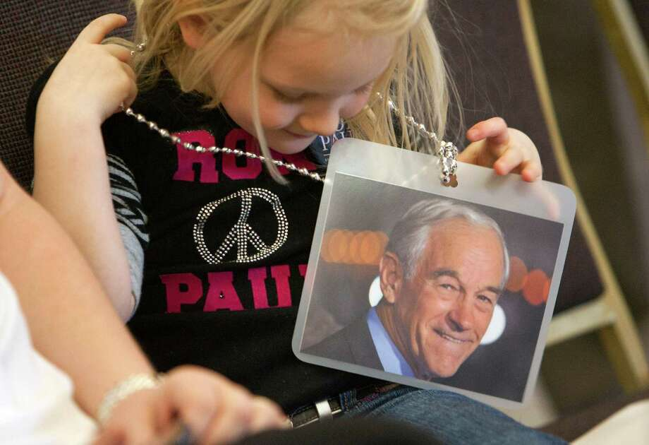 Sydney Walker, 4, holds a picture of Republican presidential candidate Ron Paul before he spoke at a rally on Tuesday, March 6, 2012 in Nampa, Idaho. Photo: Katherine Jones, Associated Press / Idaho Statesman