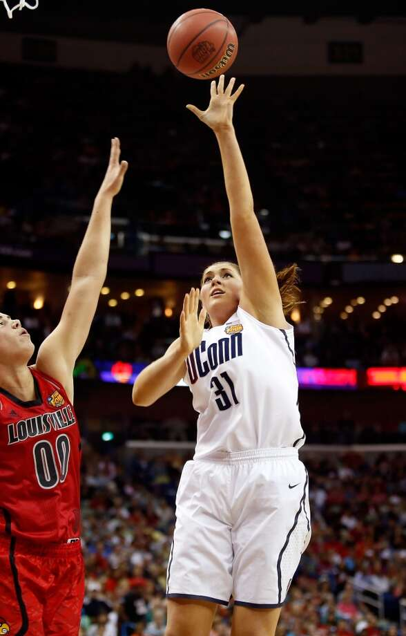 Stefanie Dolson #31 of the Connecticut Huskies shoots against Sara Hammond #00 of the Louisville Cardinals in the first half during the 2013 NCAA Women\'s Final Four Championship at New Orleans Arena on April 9, 2013 in New Orleans, Louisiana.