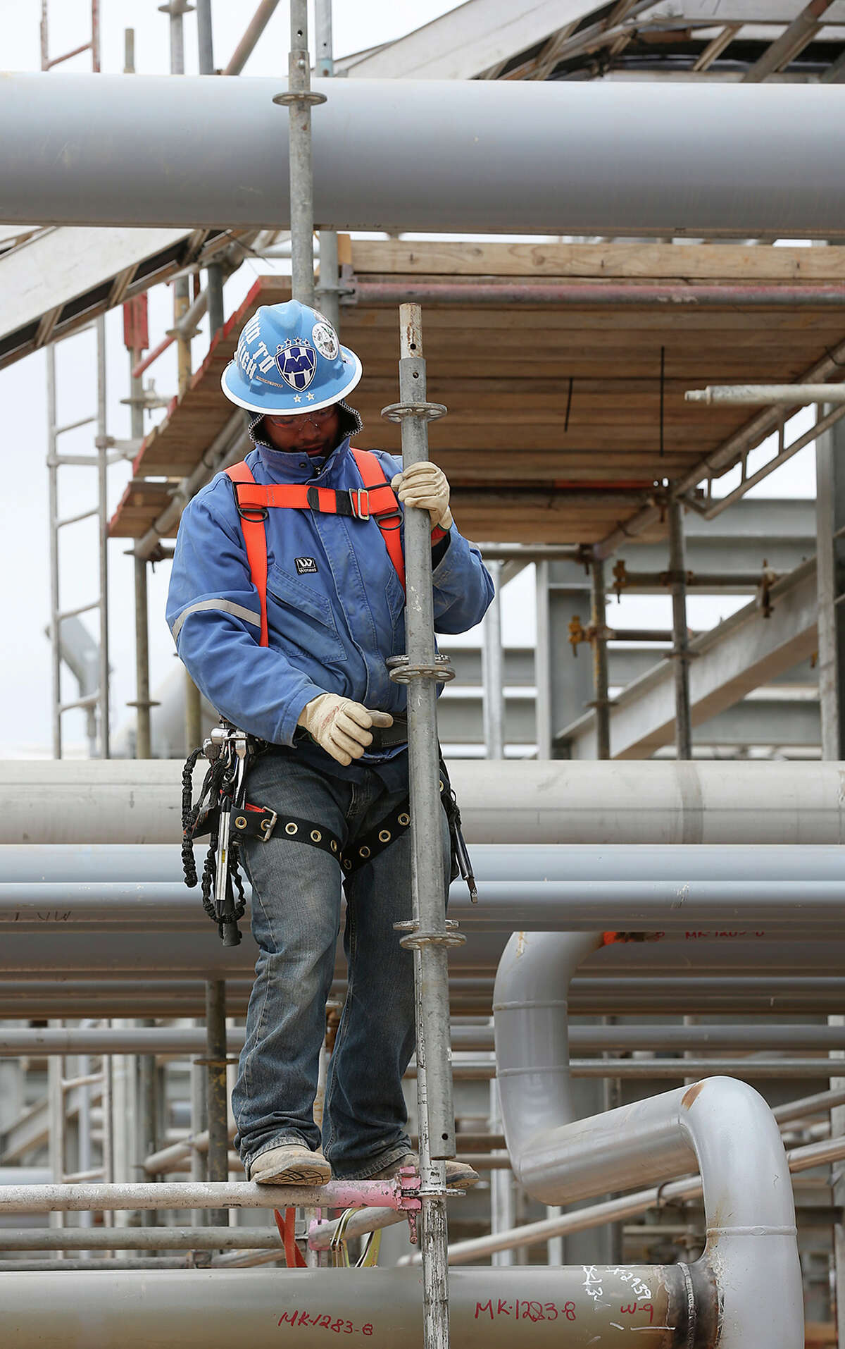 A worker sets up scaffolding as work continues at the Anadarko Brasada Gas Plant in La Salle County south of Cotulla, Wednesday, March 27, 2013. >>OLD TIMERS: What oil-industry roughnecks used to look like