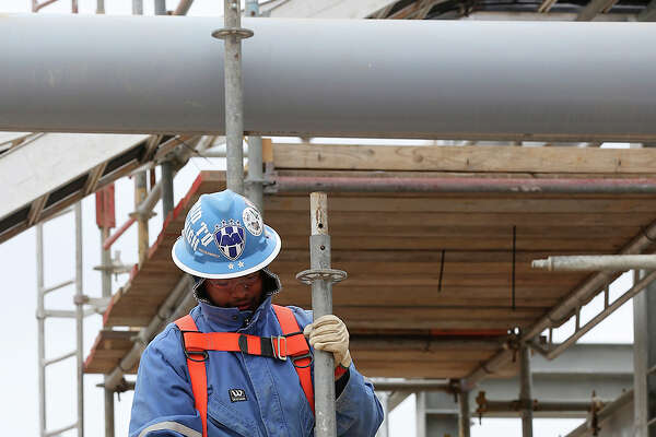 A worker sets up scaffolding as work continues at the Anadarko Brasada Gas Plant in La Salle County south of Cotulla, Wednesday, March 27, 2013. The $100 million plant will have a capacity of 200 million cubic feet of natural gas per day. The plant will be able to extract ethane, butane, propane and other gasses from the natural gas before it is transported to various markets through pipelines.