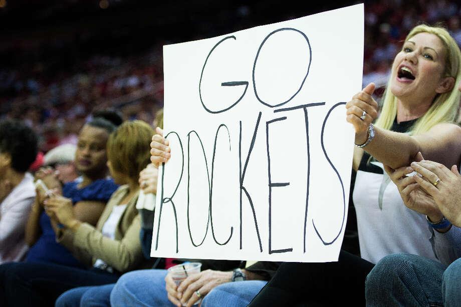 Rockets fans cheer their team against the Suns. Photo: Smiley N. Pool , Houston Chronicle / © 2013  Houston Chronicle