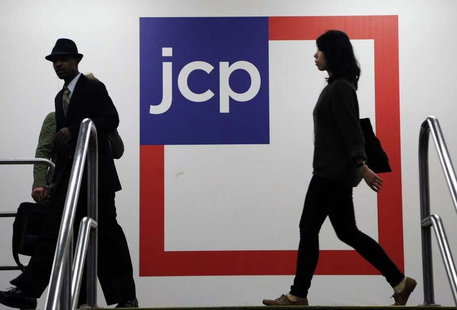 Customers arrive Tuesday at a J.C. Penney store in New York. This week, the Plano-based chain ousted Ron Johnson after 17 months as chief executive. Photo: Mark Lennihan, STF / AP