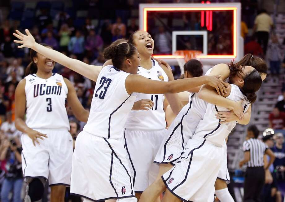 Kaleena Mosqueda-Lewis #23 of the Connecticut Huskies celebrates with teammates after defeating the Louisville Cardinals during the 2013 NCAA Women\'s Final Four Championship at New Orleans Arena on April 9, 2013 in New Orleans, Louisiana.