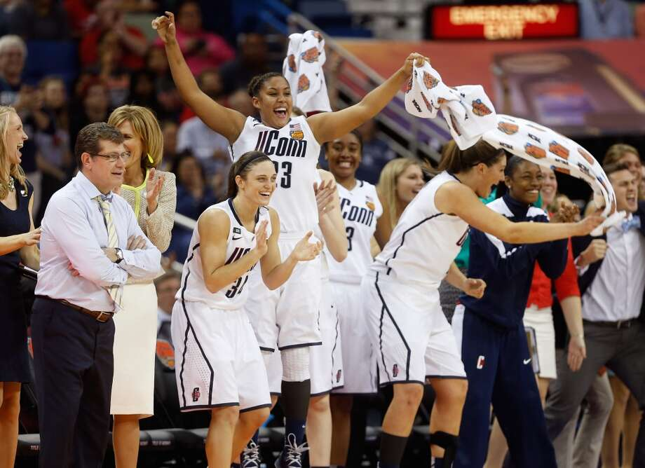 Kelly Faris #34, Kaleena Mosqueda-Lewis #23 and head coach Geno Auriemma of the Connecticut Huskies celebrate on the bench late in the game against the Louisville Cardinals during the 2013 NCAA Women\'s Final Four Championship at New Orleans Arena on April 9, 2013 in New Orleans, Louisiana.