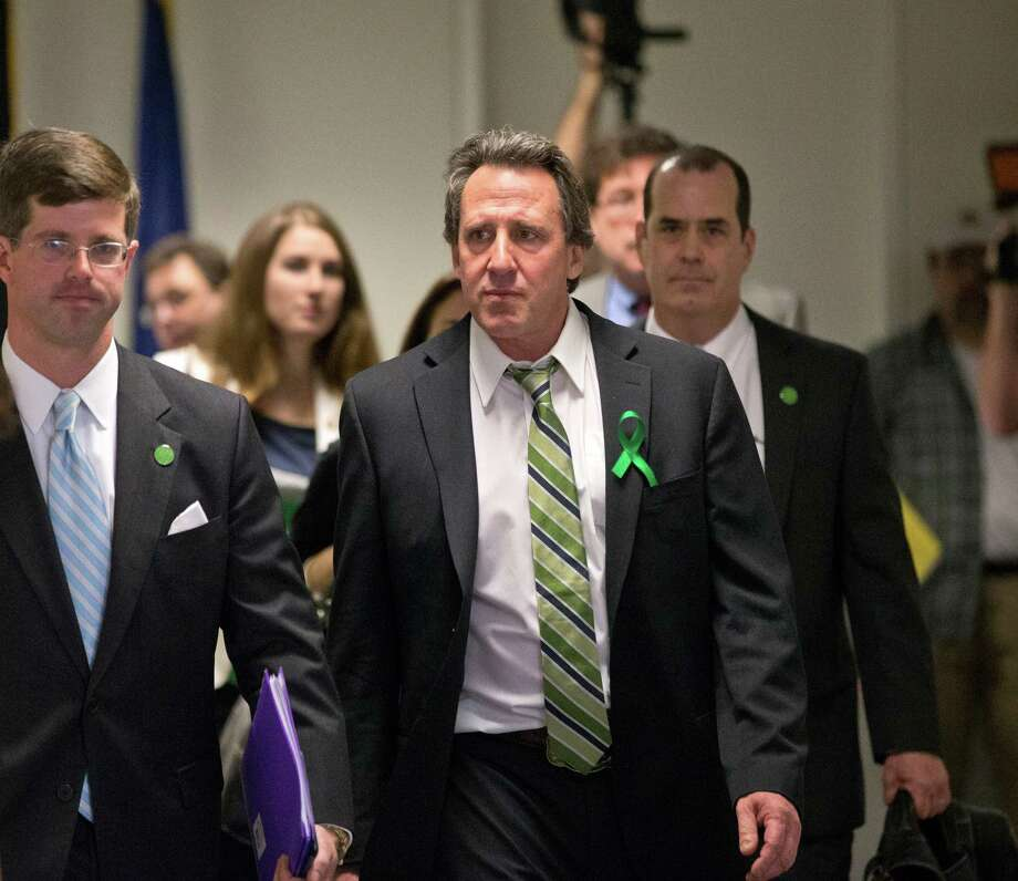 Neil Heslin, center, whose 6-year-old son Jesse was killed in the mass shooting in Newtown, Conn., arrives with other victims' families to meet privately on Capitol Hill in Washington, Tuesday, April 9, 2013, with Sen. Richard Blumenthal, D-Conn., and Sen. Chris Murphy, D-Conn. Heslin gave moving testimony during a Senate Judiciary Committee hearing in February on the proposed assault weapons ban.  (AP Photo/J. Scott Applewhite) Photo: J. Scott Applewhite