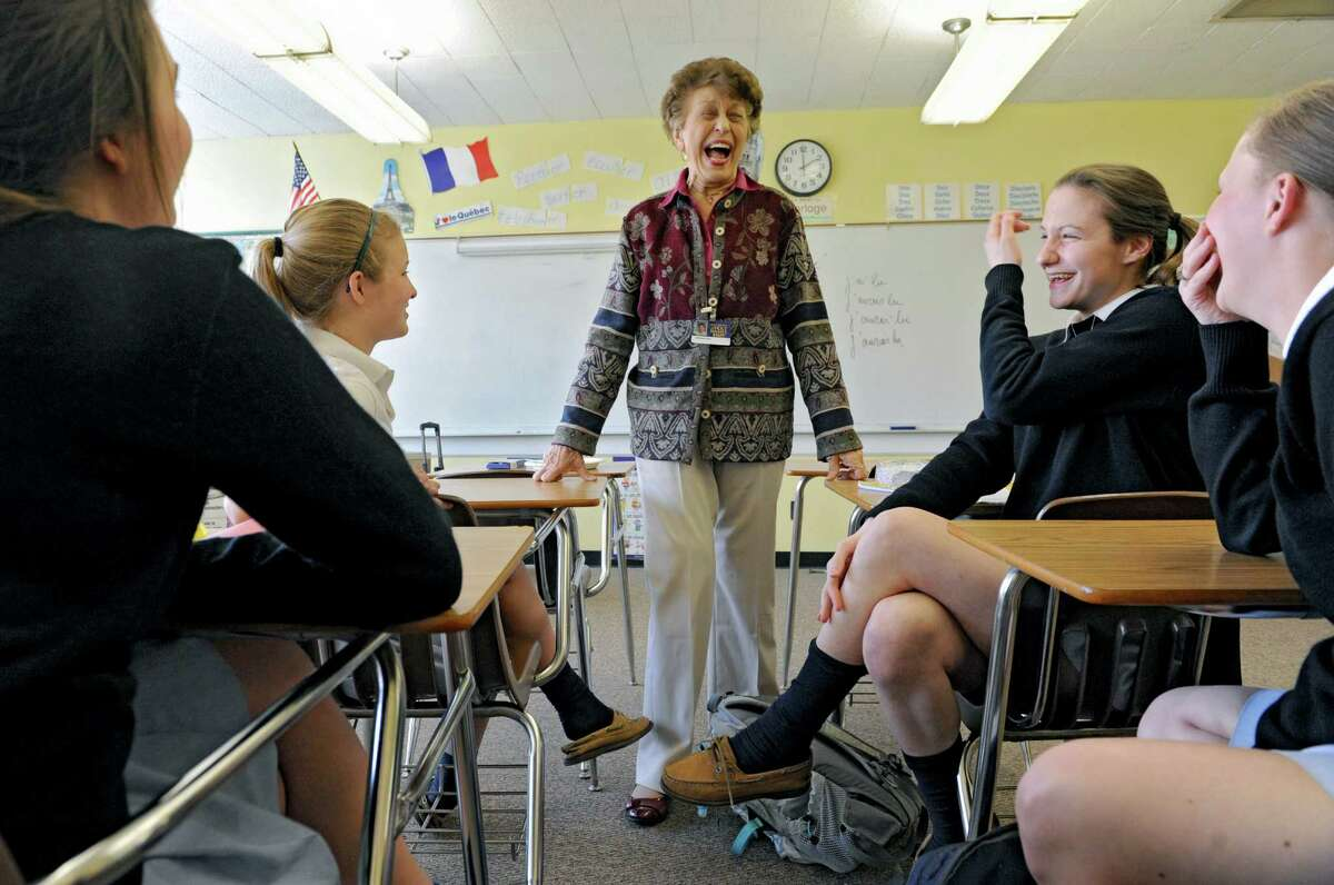 Ninety-year-old french teacher Germaine Graf has fun with her advanced french class at Academy of the Holy Names school on Tuesday, April 9, 2013 in Albany, N.Y. The junior girls are, from left, Zoe Reszytniak, Grace Cummings, Rachel Reichel and Sara Welsh. Graf has announced she'll retire at the end of this year. (Lori Van Buren / Times Union)