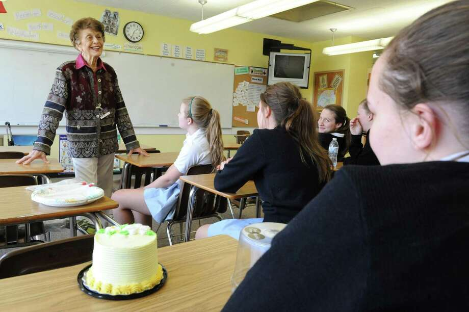 Ninety-year-old french teacher Germaine Graf teaches an advanced french class at Academy of the Holy Names school on her birthday on Tuesday, April 9, 2013 in Albany, N.Y. Her class gave her a birthday cake, card and presents. Graf has announced she'll retire at the end of this year. (Lori Van Buren / Times Union) Photo: Lori Van Buren