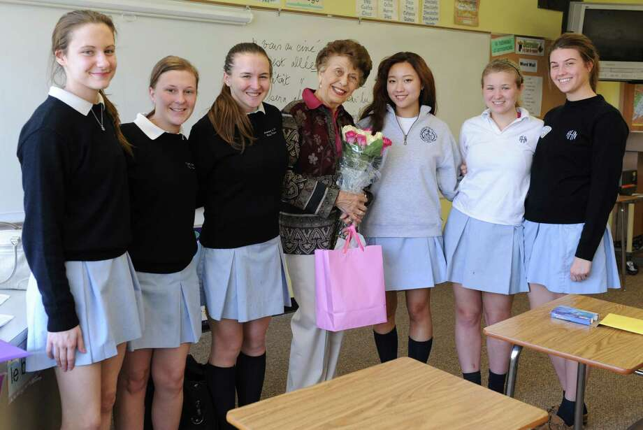 90-year-old french teacher Germaine Graf poses on her birthday with her advanced french class at Academy of the Holy Names school on Tuesday, April 9, 2013 in Albany, N.Y. The students from left are Rachel Reichel, Sara Welsh, Regan Edwards, Byeol Hong, Grace Cummings and Zoe Reszytniak. All the students are juniors except Hong who is a senior. Graf has announced she'll retire at the end of this year. (Lori Van Buren / Times Union) Photo: Lori Van Buren