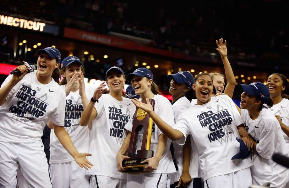 Kelly Faris #34 of the Connecticut Huskies (C) holds up the National Championship Trophy with her teammates after defeating the Louisville Cardinals during the 2013 NCAA Women\'s Final Four Championship at New Orleans Arena on April 9, 2013 in New Orleans, Louisiana.
