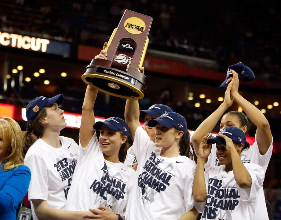 Breanna Stewart #30, Caroline Doty #5 and Kelly Faris #34 of the Connecticut Huskies hold up the National Championship Trophy with their teammates after defeating the Louisville Cardinals during the 2013 NCAA Women\'s Final Four Championship at New Orleans Arena on April 9, 2013 in New Orleans, Louisiana.