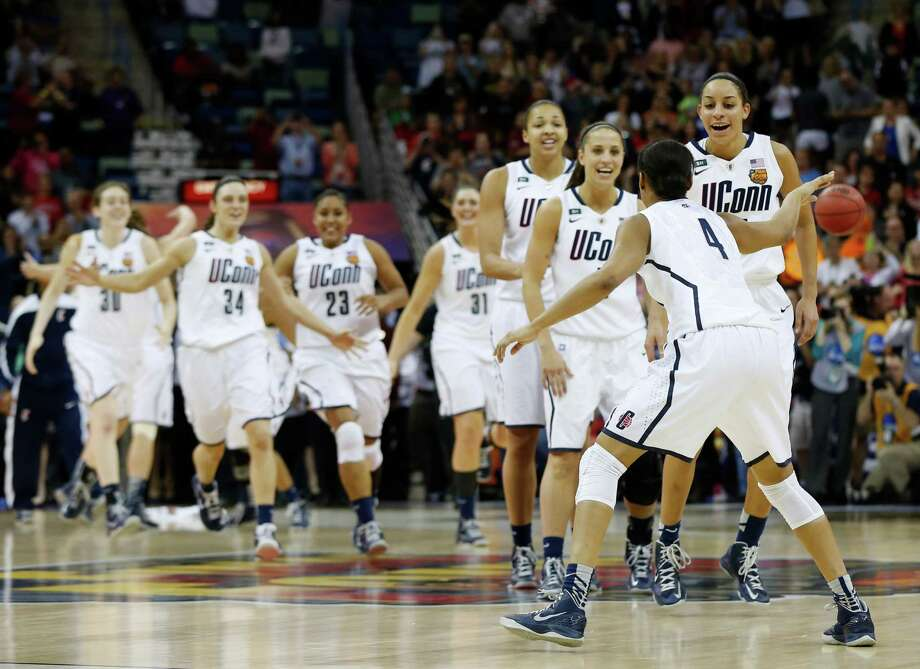 Connecticut players celebrate after defeating Louisville 93-60 in the national championship game of the women's Final Four of the NCAA college basketball tournament, Tuesday, April 9, 2013, in New Orleans. (AP Photo/Dave Martin) Photo: Dave Martin, Associated Press / AP