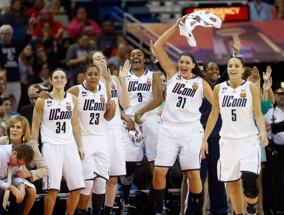 Kelly Faris #34, Kaleena Mosqueda-Lewis #23, Breanna Stewart #30, Morgan Tuck #3, Stefanie Dolson #31 and Caroline Doty #5 of the Connecticut Huskies celebrate late in the game against the Louisville Cardinals during the 2013 NCAA Women\'s Final Four Championship at New Orleans Arena on April 9, 2013 in New Orleans, Louisiana.