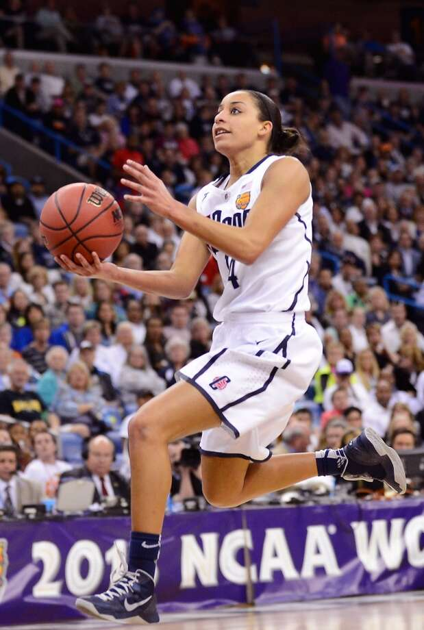 Bria Hartley #14 of the Connecticut Huskies drives with the ball against the Louisville Cardinals in the second half during the 2013 NCAA Women\'s Final Four Championship at New Orleans Arena on April 9, 2013 in New Orleans, Louisiana.
