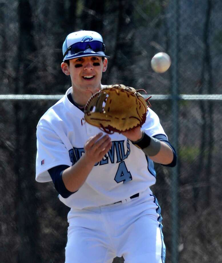 Junior shortstop Kevin Smith plays catch before the third inning of the Columbia - Mohonasen baseball game held at the Columbia High School field April 5, 2013, in East Greenbush, N.Y.     (Skip Dickstein/Times Union) Photo: SKIP DICKSTEIN / 10021857A