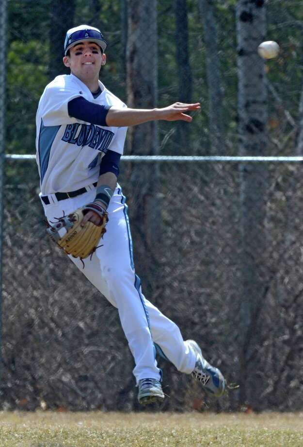 Junior shortstop Kevin Smith throws an opposing player out in the third inning of the Columbia - Mohonasen baseball game held at the Columbia High School field April 5, 2013, in East Greenbush, N.Y.     (Skip Dickstein/Times Union) Photo: SKIP DICKSTEIN / 10021857A