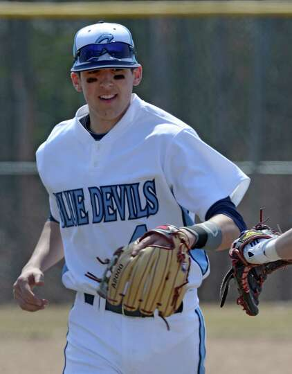 Junior shortstop Kevin Smith returns to the dugout after the third inning of the Columbia - Mohonase