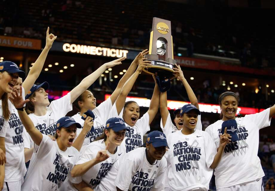The Connecticut Huskies celebrate after defeating the Louisville Cardinals during the 2013 NCAA Women\'s Final Four Championship at New Orleans Arena on April 9, 2013 in New Orleans, Louisiana.