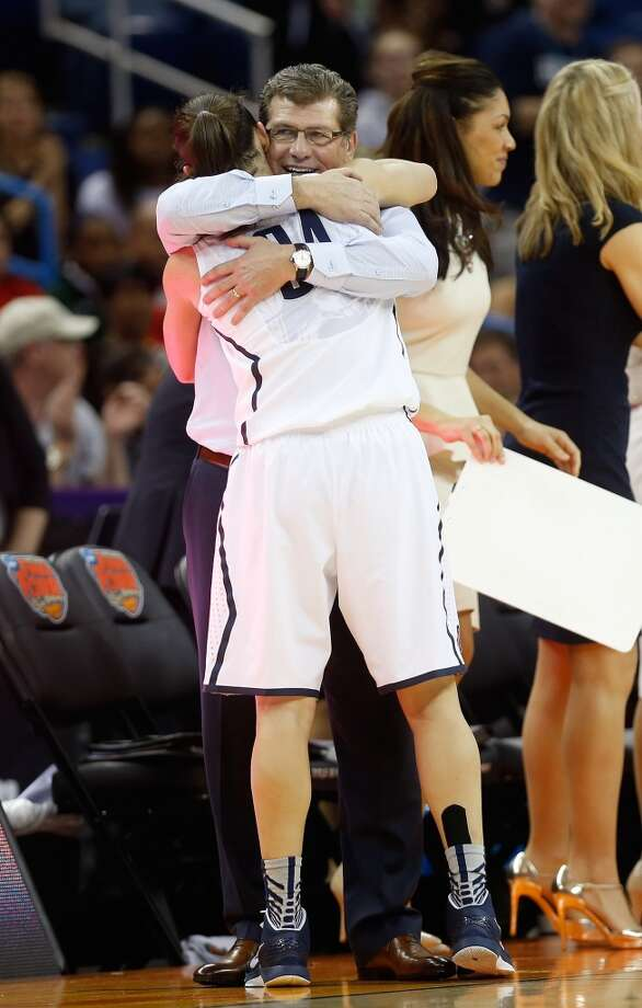 Head coach Geno Auriemma of the Connecticut Huskies hugs Kelly Faris #34 as she exits the game in the second half against the Louisville Cardinals during the 2013 NCAA Women\'s Final Four Championship at New Orleans Arena on April 9, 2013 in New Orleans, Louisiana.