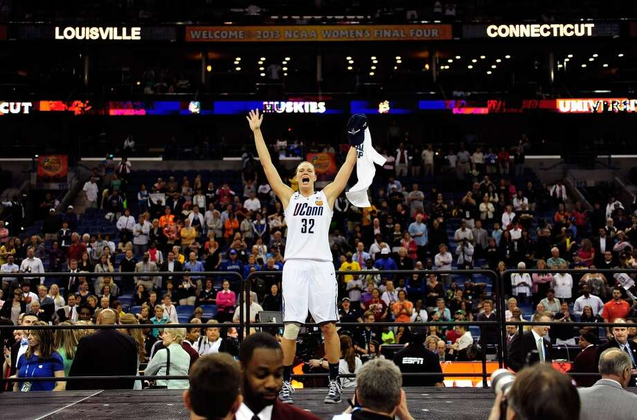 Heather Buck #32 of the Connecticut Huskies celebrates after defeating the Louisville Cardinals during the 2013 NCAA Women\'s Final Four Championship at New Orleans Arena on April 9, 2013 in New Orleans, Louisiana.
