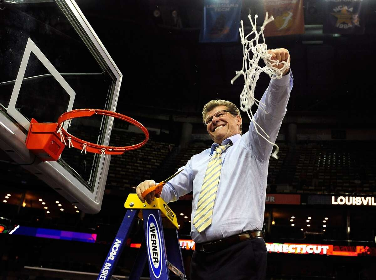 Head coach Geno Auriemma of the Connecticut Huskies cuts down the net after defeating the Louisville Cardinals during the 2013 NCAA Women\'s Final Four Championship at New Orleans Arena on April 9, 2013 in New Orleans, Louisiana.